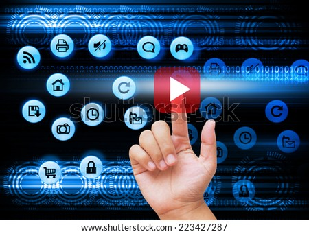 Hand pressing red play buttons on technology background  - stock photo