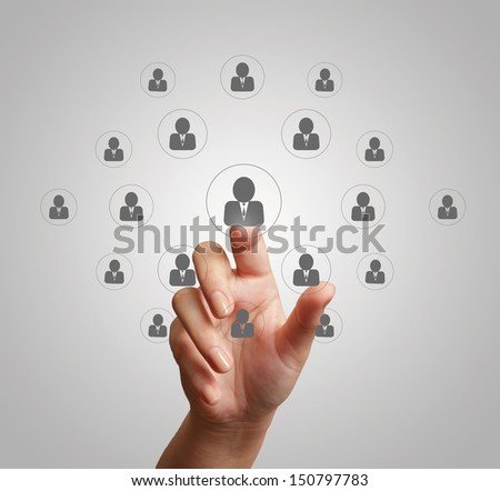hand pressing social media icon as concept - stock photo