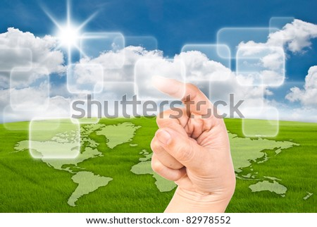 Hand pressing transparent button on the blue sky field. - stock photo