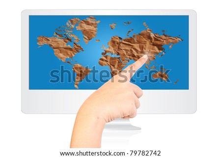 Hand pressing vintage world map on the monitor screen. - stock photo