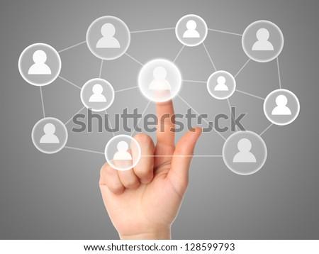 Hand pressing virtual social media icon - stock photo