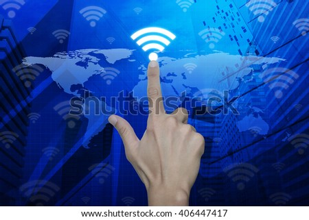 Hand pressing wi-fi button over map and city background, Technology and internet concept, Elements of this image furnished by NASA - stock photo