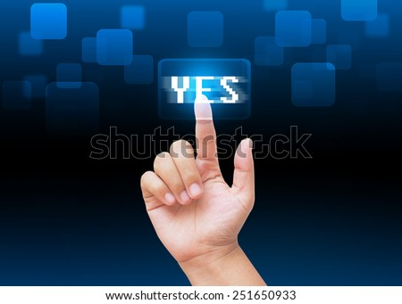Hand pressing YES buttons with technology background  - stock photo