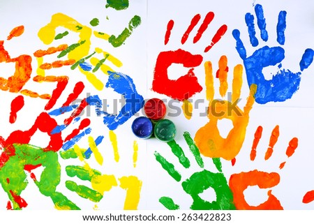 Hand prints of paint with paint on white background - stock photo
