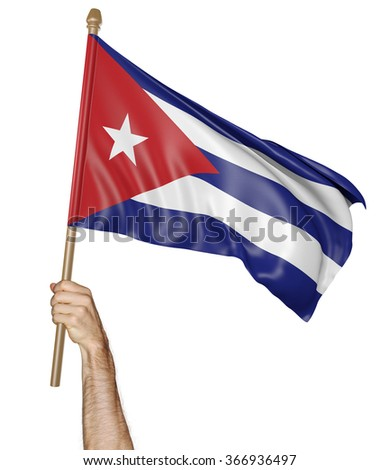 Hand proudly waving the national flag of Cuba - stock photo