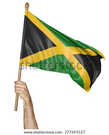 Hand proudly waving the national flag of Jamaica - stock photo