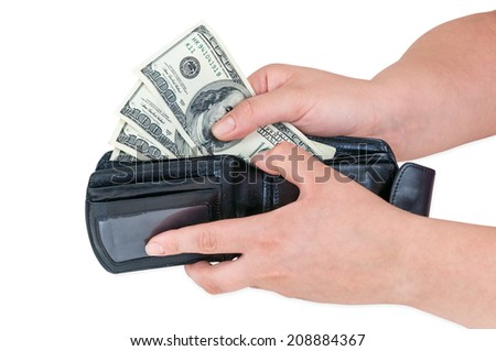 Hand pulling 100 dollars banknotes from wallet isolated on white background with clipping path - stock photo