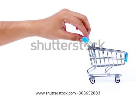 Hand push the shopping cart - stock photo