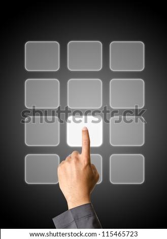 Hand pushing a botton - stock photo