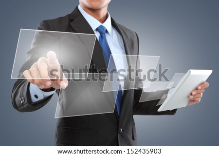 hand pushing a button on a touch screen interface while using tablet PC - stock photo