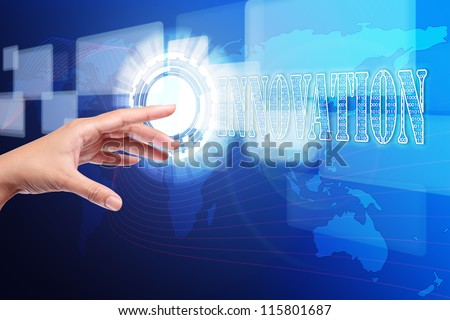 hand pushing a innovation button on touch screen interface, hi-technology - stock photo