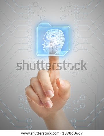 Hand pushing futuristic button and performing magnetic resonance of human brain. - stock photo