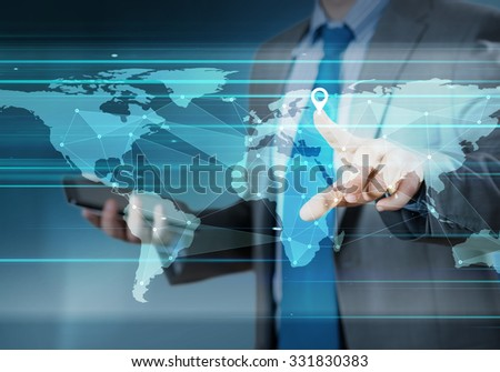 Hand pushing global network button on touch screen interface - stock photo