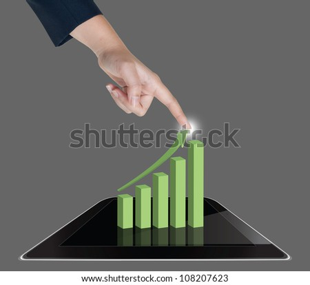 Hand pushing graph of tablet on a touch screen interface - stock photo