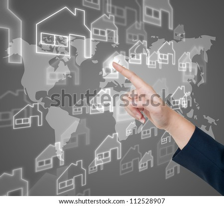 Hand pushing home button on a touch screen interface - stock photo