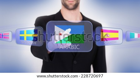 Hand pushing on a touch screen interface, choosing language or country, Djibouti - stock photo