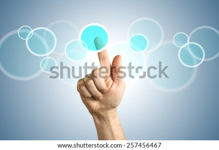 hand pushing on a touch screen interface , close-up shot. - stock photo
