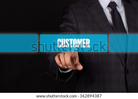 Hand pushing on a touch screen interface-CUSTOMER button - stock photo