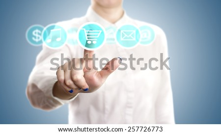 hand pushing on a touch screen interface , online shopping. - stock photo
