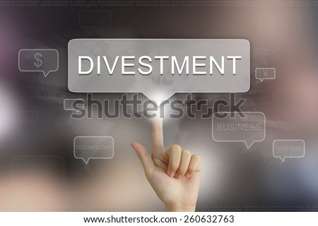 hand pushing on divestment balloon text button - stock photo