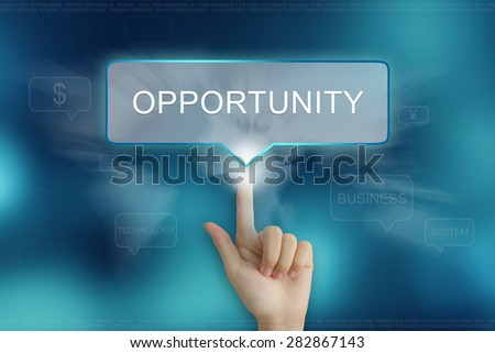 hand pushing on opportunity balloon text button - stock photo