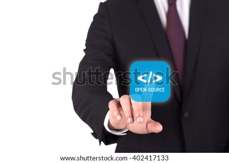 Hand pushing OPEN SOURCE button on interface touch screen - stock photo
