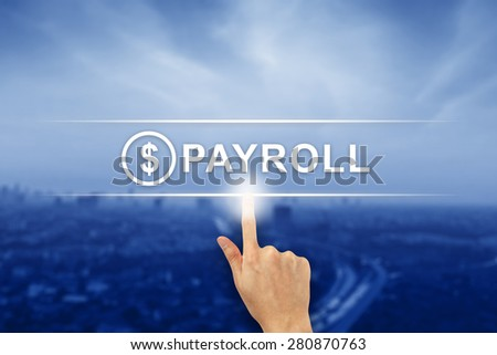 hand pushing payroll button on a virtual screen interface - stock photo