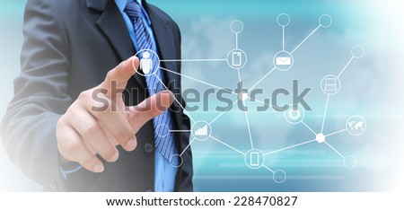 hand pushing social network button on a touch screen interface  - stock photo