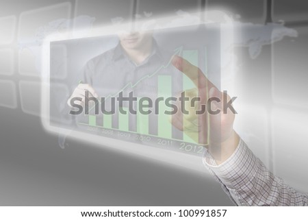 Hand pushing Success button on a touch screen interface. - stock photo