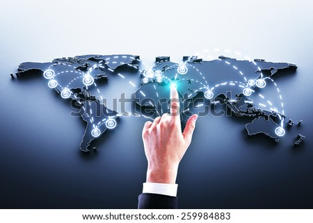 hand pushing world map interface on blue background - stock photo