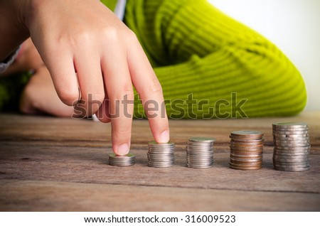 hand put the coin on each line rising - business concept. - stock photo