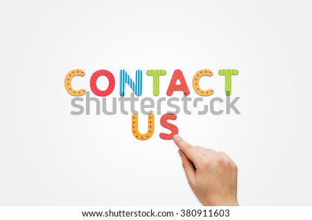 Hand put the words Contact Us with magnetic letters. Colorful alphabet kit - stock photo