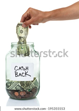 hand putting a dollar bill in a cash back savings jar - stock photo