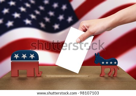 Hand putting a voting ballot to wooden box on Flag of USA, party icon - stock photo