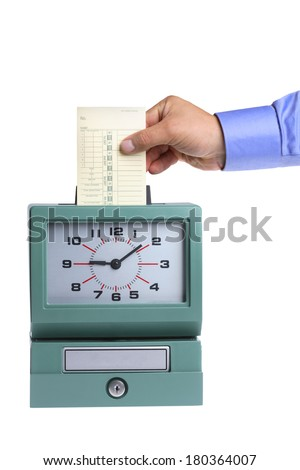 Hand putting card in time clock on white background - stock photo