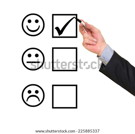 Hand putting check mark on customer service evaluation form - stock photo