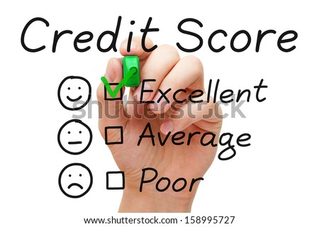 Hand putting check mark with green marker on excellent credit score evaluation form. - stock photo