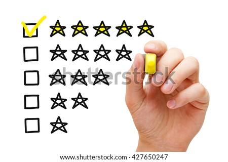 Hand putting check mark with yellow marker on five star rating. Customer satisfaction concept. - stock photo