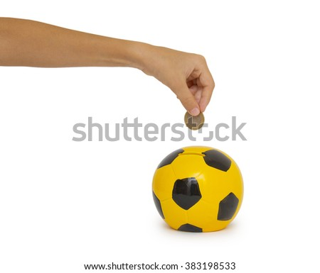 hand putting coin into a moneybox - stock photo