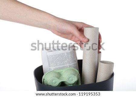 Hand putting paper garbage for recycle, isolated - stock photo