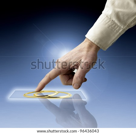 hand reaching images streaming from future screen - stock photo