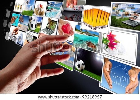 Hand reaching streaming multimedia from internet. All images coming from my gallery. - stock photo