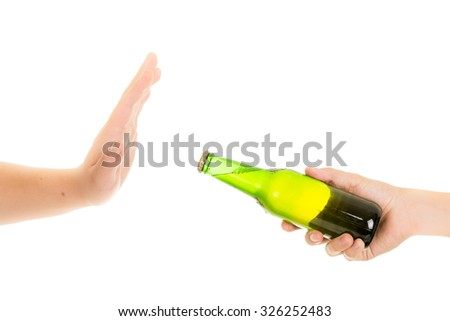 hand rejects a bottle of beer - stock photo