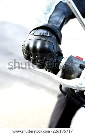 Hand rider on handlebars, close-up - stock photo