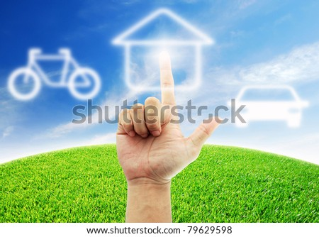 Hand select home for the future - stock photo