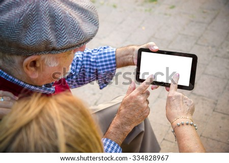 Hand senior man an woman using Cell phone - stock photo