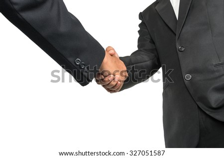 Hand shake between businessman on white background - stock photo