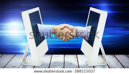 Hand shake in front of wires against black background with spark - stock photo