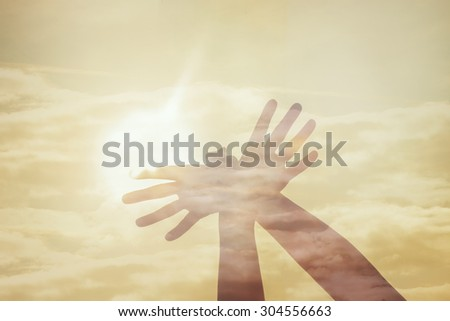 hand shaped bird fly on the sun sky double exposure - stock photo
