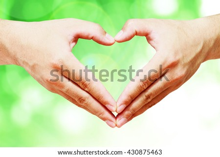 Hand shaped bokeh blur forest green background. Ecology Life Spring Assured Food Trust Healthy Brain Wealth Wisdom Save System eco love soil 5 csr june leaf care plant happy logo label grow power save - stock photo